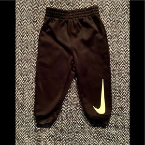 Nike dry for black sweat pants with swish logo on the front size 18m